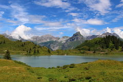 Still Alpine Lake. Trübsee, a lake above Engelberg in the foot of Mount Titlis Royalty Free Stock Photo