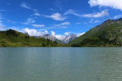 Still Alpine Lake. Trübsee, a lake above Engelberg in the foot of Mount Titlis Royalty Free Stock Photos