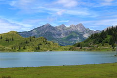 Still Alpine Lake. Trübsee, a lake above Engelberg in the foot of Mount Titlis Royalty Free Stock Images