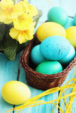 Still basket and eggs Stock Image