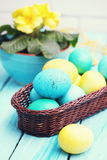 Still basket and eggs, tinted. Easter still life basket of colored eggs Stock Image