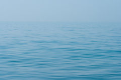Still calm sea ocean water surface and horizon Stock Images