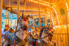 Still Carousel Or Marry-Go-Round With Light Decoration Focus On. The Front Horse In Night Atmosphere Stock Images