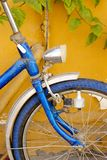 Still colorful bike. Still life- colorful bike leaning on the wall stock photo