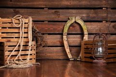 Still in cowboy style on wooden boards. Stock Photography