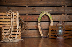 Still in cowboy style on wooden boards. Stock Photo