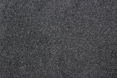 Still dark black paper texture background with clearly detailed natural grain noise texture effect. Close up detail textured sheet of paper with black and stock photography