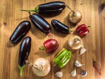Still eggplant paprika bow garlic. Top view Stock Photography