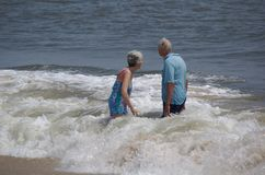 Still enjoying life. Mature couple enjoying the summer surf stock images