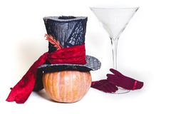 Magic hat and  huge glass of pumpkin Royalty Free Stock Images