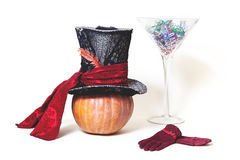 Still Fabulous. Hat, pumpkin, gloves and  huge glass. Magic still life. Big hat cylinder ripe pumpkin and huge glass martini glass on a white background Royalty Free Stock Images