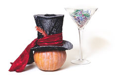Still Fabulous. Hat, pumpkin and huge glass on white background. Magic still life. Big hat cylinder ripe pumpkin and huge glass martini glass on a white Royalty Free Stock Photography