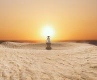 Zen Master Meditating in the desert. Figure sitting in meditation on the sand during sunset Stock Photography