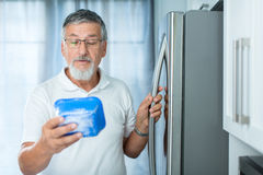 Is this still fine? Senior man in his kitchen Royalty Free Stock Image