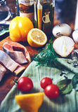 Still fish vegetables. Still life of vegetables on a table fish with herbs Stock Images