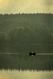 Still fishing. The lake is calm and it is a beautiful afternoon Stock Photos