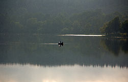 Still fishing. The lake is calm and it is a beautiful afternoon Stock Image
