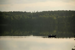 Still fishing. The lake is calm and it is a beautiful afternoon Stock Images
