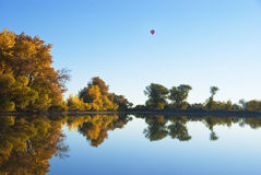 Still Lake With Balloon Above Royalty Free Stock Photography