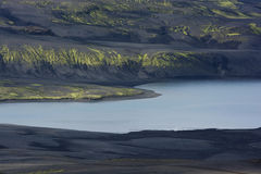 Still lake among black hills, Iceland Royalty Free Stock Photos