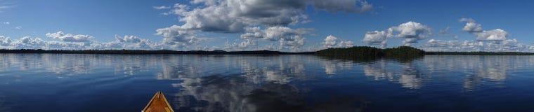 Still lake panorama with canoe Royalty Free Stock Photo