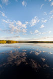 Still lake perfect reflection of sky and clouds Royalty Free Stock Photography