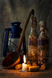 Still-life. The still-life of two bottles, candle, corks, ladle and lamp Royalty Free Stock Image