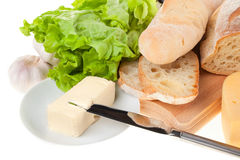 Still life. Table knife, lettuce, bread, cheese and butter Royalty Free Stock Photo