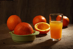 Still life. Orange juice in glass and oranges. Still life Royalty Free Stock Photo