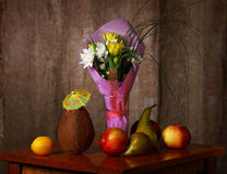 Still life. Vase with flowers. Fruit. Coconut. Still life Stock Photography