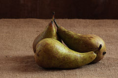 Still life. Three pears lie on a table. Still life Stock Images