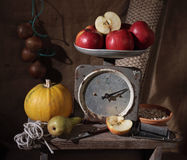 Still life. One kilogram of apples. Old spring-balance. Still life Stock Photo