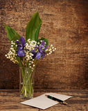 Still-life. Bouquet of lily of the valley  with blue irises Stock Photo