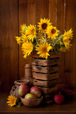Still Life. With Sunflowers and Apples Royalty Free Stock Photos