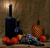 Still life. With old vases, apples and grape stock photography