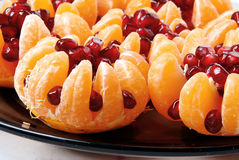 Still life. Beautiful still life of tangerine stuffed with pomegranate seeds Stock Photo