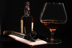 Still Life. Still Life With Bottle, Pipe, Glass And Open Book Stock Image