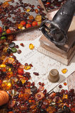 Still-life with amber and sewing machines. Stones amber colored, old postcards and a small sewing machine Stock Photography