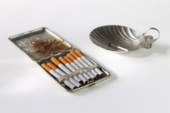 Still life with an ancient cigarette case. Cigarettes and an ashtray Stock Photo