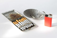 Still life with an ancient cigarette case. Cigarettes and an ashtray Royalty Free Stock Photos