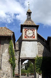 Still life of ancient town gate, city Saint-Prex. Switzerland: On the tower of this historic, medieval, building there is a big, colourful clock, timepiece. This Stock Photography