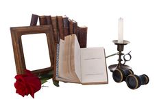 Still life with antique books and picture frames Royalty Free Stock Images