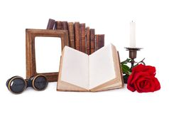 Still life with antique books and picture frames. Royalty Free Stock Images