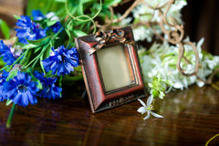 Still life with antique ornate frame. Royalty Free Stock Image