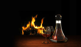 Still life with aperitif or digestif and fire place Royalty Free Stock Photos