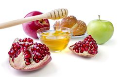 Still life appetizing challah, apples, pomegranate and bowl of h Royalty Free Stock Images