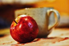 Still Life with Apple and bowl Royalty Free Stock Photo