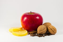 Still Life apple,lemon, cinnamon, cloves, nuts. Royalty Free Stock Images