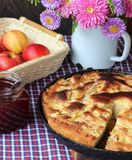 Apple pie and strawberry jam. Still life. Royalty Free Stock Photography
