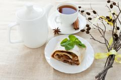 Still-life with apple pie, tea and dry branch on homemade canvas Royalty Free Stock Images